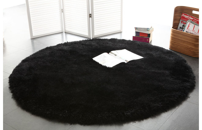 tapis shaggy rond noir 150 cm ugo miliboo. Black Bedroom Furniture Sets. Home Design Ideas